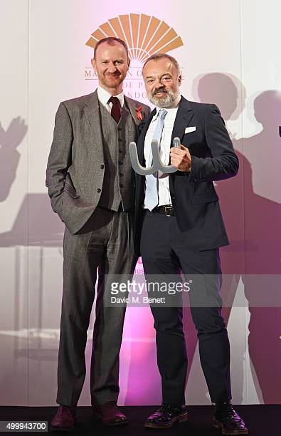 Mark Gatiss and Graham Norton winner of the Winq Man Of The Year award pose onstage at the Winq Magazine Men of the Year lunch to benefit the Elton...