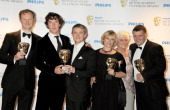 Mark Gatiss Benedict Cumberbatch Martin Freeman Sue Vertue Beryl Vertue and Steven Moffat of Sherlock Holmes pose in front of the winners boards at...