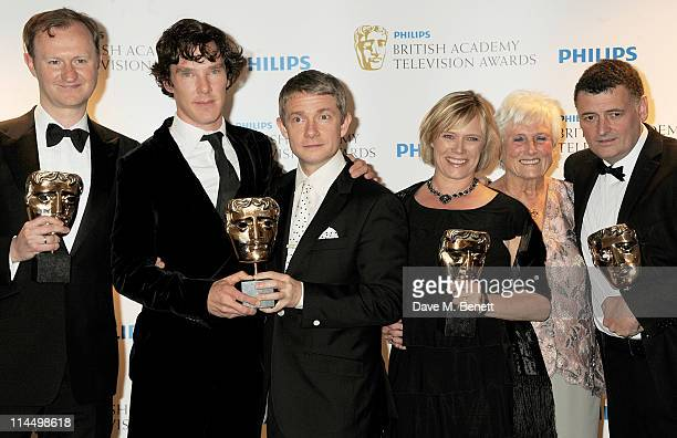 Mark Gatiss Benedict Cumberbatch Martin Freeman Sue Vertue Beryl Vertue and Steven Moffat of Sherlock Holmes pose in front of the winners boards at...