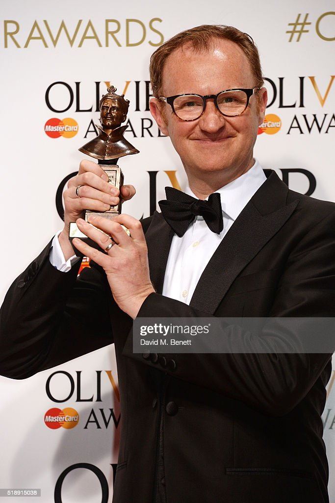 Mark Gatiss winner of the Best Actor In A Supporting Role award for 'Three Days In The Country' poses in the Winners Room at The Olivier Awards with...
