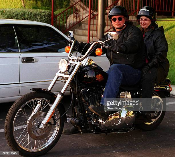 Mark Geiser and Cheri Geiser arrive at the West Coast Bikers Ball on a Harley During the ball at the Galaxy Theater Santa Ana