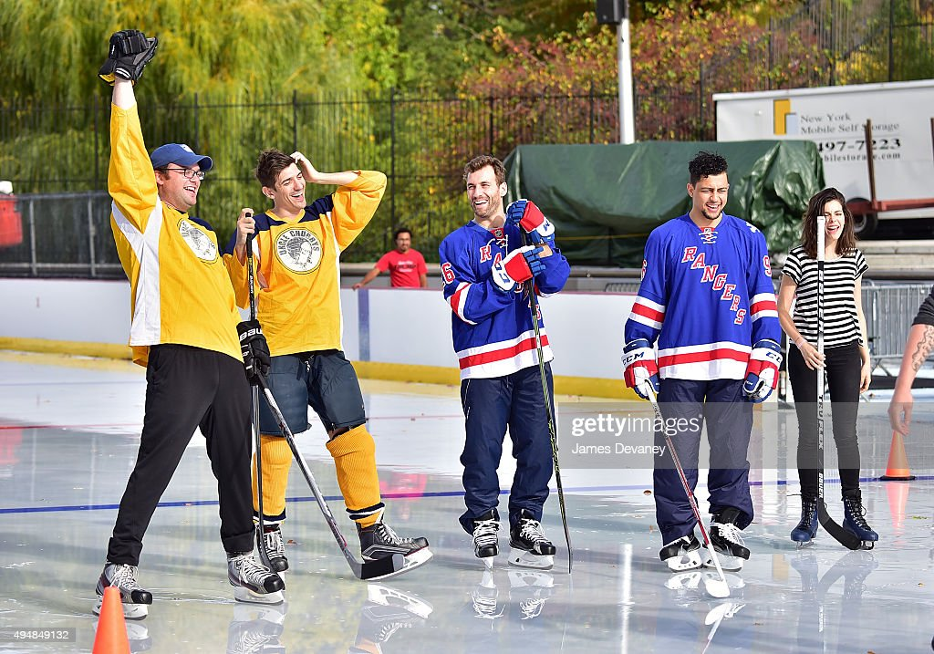 Mark Gessner, Andrew Schulz, Jarrett Stoll, Emerson Etem and Lindsey Broad attend the New York Rangers and the Cast of IFCÕs Hockey Comedy Benders Face Off event at Lasker Rink on October 29, 2015 in New York City.