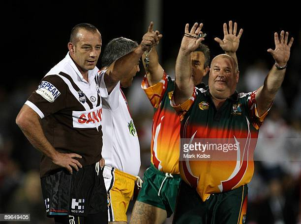 Mark Geyer of the Panthers legends is sent to the sinbin in the legends Curtain raiser match before the round 22 NRL match between the Penrith...
