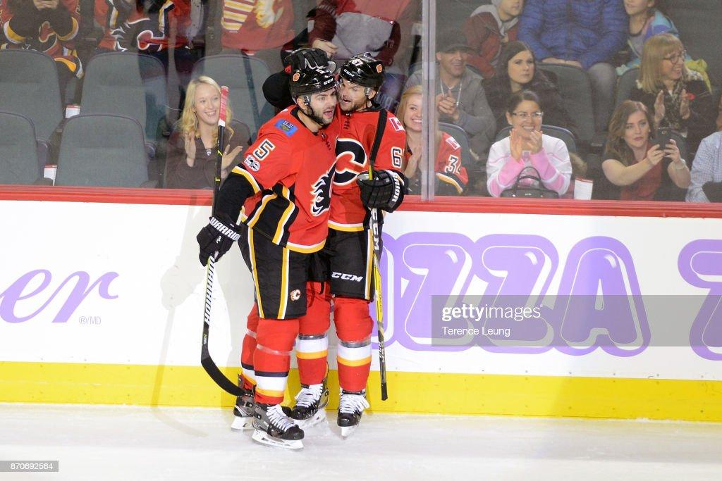 a3c1e9c44 ... Mark Giordano 5 and Michael Frolik 67 of the Calgary Flames celebrate a  goal ...