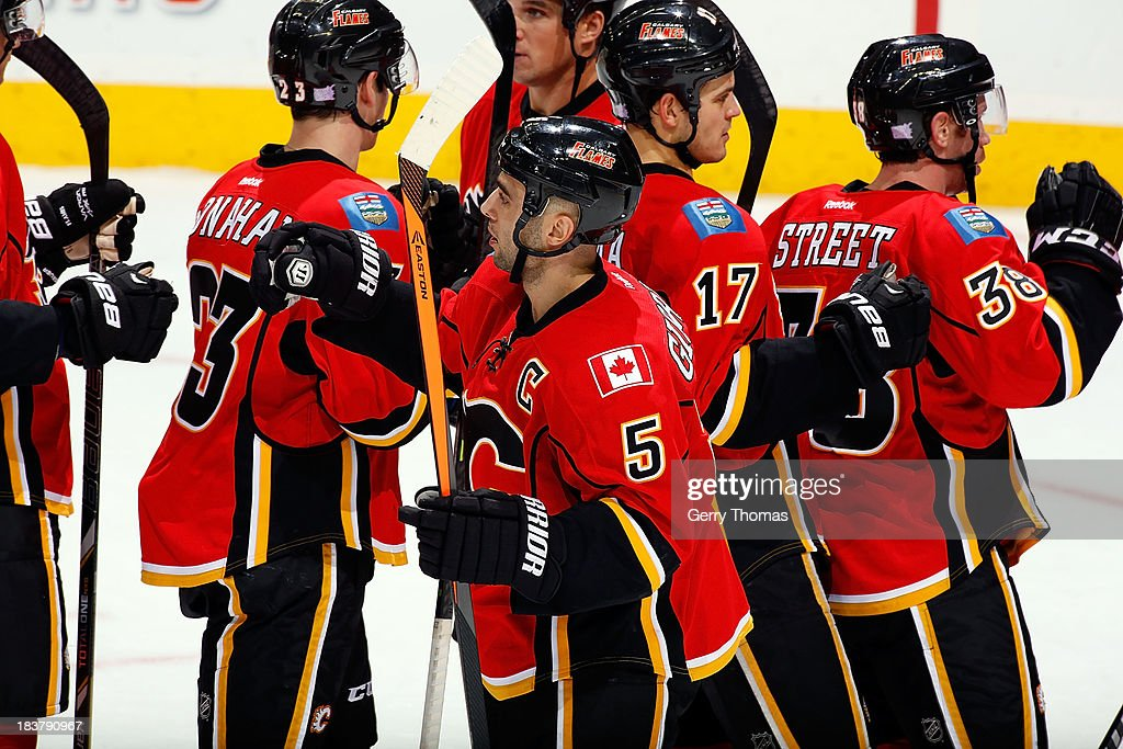 <a gi-track='captionPersonalityLinkClicked' href=/galleries/search?phrase=Mark+Giordano&family=editorial&specificpeople=696867 ng-click='$event.stopPropagation()'>Mark Giordano</a> #5 and teammates of the celebrate a 3-2 win over the Montreal Canadiens at Scotiabank Saddledome on October 9, 2013 in Calgary, Alberta, Canada.