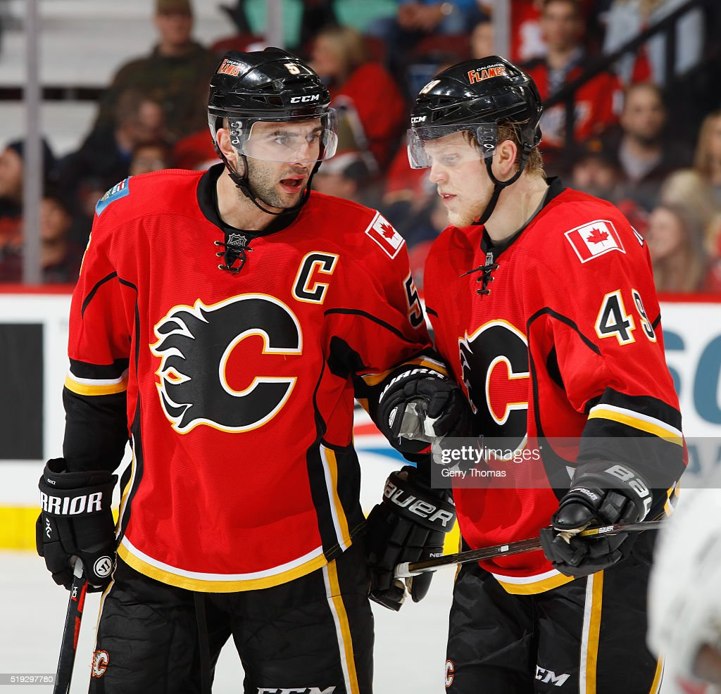 Mark Giordano #5 has last minute instructions for Hunter Shinkaruk #49 of the Calgary Flames against the Los Angeles King at Scotiabank Saddledome on April 5, 2016 in Calgary, Alberta, Canada.