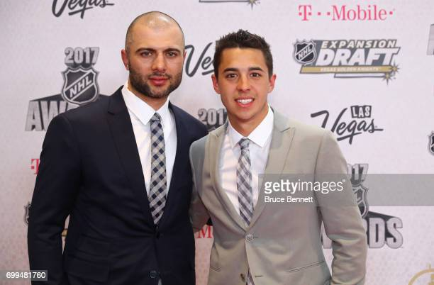 Mark Giordano left and Johnny Gaudreau of the Calgary Flames attend the 2017 NHL Awards at TMobile Arena on June 21 2017 in Las Vegas Nevada