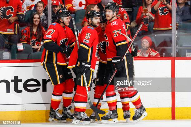 Mark Giordano Mark Jankowski Dougie Hamilton and Matthew Tkachuk of the Calgary Flames celebrate in an NHL game against the St Louis Blues at the...