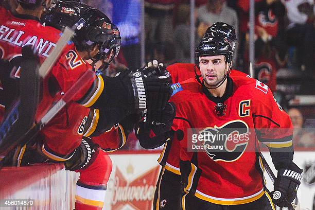 Mark Giordano of the Calgary Flames celebrates with the bench after scoring against the Montreal Canadiens during an NHL game at Scotiabank...