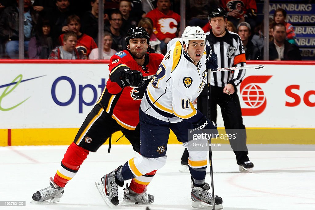 <a gi-track='captionPersonalityLinkClicked' href=/galleries/search?phrase=Mark+Giordano&family=editorial&specificpeople=696867 ng-click='$event.stopPropagation()'>Mark Giordano</a> #5 of the Calgary Flames checks <a gi-track='captionPersonalityLinkClicked' href=/galleries/search?phrase=Brandon+Yip&family=editorial&specificpeople=817914 ng-click='$event.stopPropagation()'>Brandon Yip</a> #18 of the Nashville Predators on March 15, 2013 at the Scotiabank Saddledome in Calgary, Alberta, Canada.