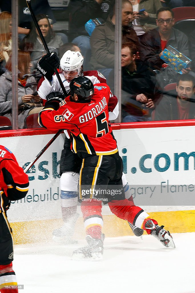 <a gi-track='captionPersonalityLinkClicked' href=/galleries/search?phrase=Mark+Giordano&family=editorial&specificpeople=696867 ng-click='$event.stopPropagation()'>Mark Giordano</a> #5 of the Calgary Flames checks <a gi-track='captionPersonalityLinkClicked' href=/galleries/search?phrase=P.A.+Parenteau&family=editorial&specificpeople=5537244 ng-click='$event.stopPropagation()'>P.A. Parenteau</a> #15 of the Colorado Avalanche on March 27, 2013 at the Scotiabank Saddledome in Calgary, Alberta, Canada.