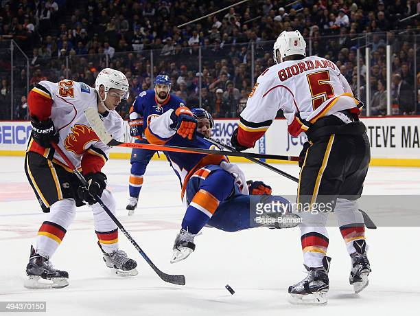 Mark Giordano of the Calgary Flames hits Frans Nielsen of the New York Islanders during the second period at the Barclays Center on October 26 2015...