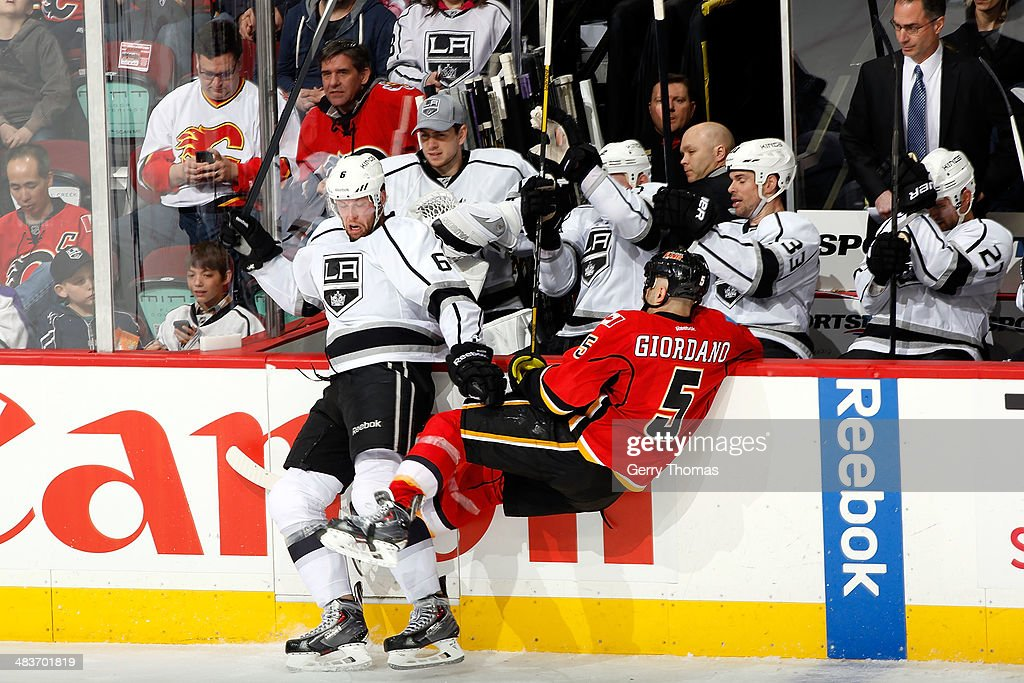 <a gi-track='captionPersonalityLinkClicked' href=/galleries/search?phrase=Mark+Giordano&family=editorial&specificpeople=696867 ng-click='$event.stopPropagation()'>Mark Giordano</a> #5 of the Calgary Flames is checked by <a gi-track='captionPersonalityLinkClicked' href=/galleries/search?phrase=Jake+Muzzin&family=editorial&specificpeople=7205557 ng-click='$event.stopPropagation()'>Jake Muzzin</a> #6 of the Los Angeles Kings at Scotiabank Saddledome on April 9, 2014 in Calgary, Alberta, Canada.