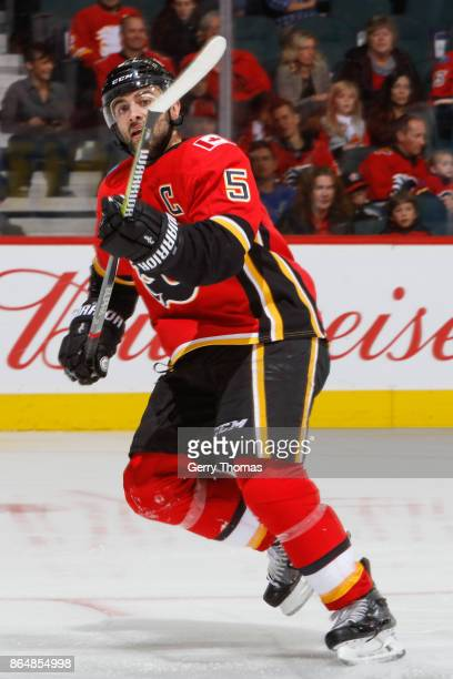 Mark Giordano of the Calgary Flames looks for a pass in an NHL game against the Minnesota Wild at the Scotiabank Saddledome on October 21 2017 in...
