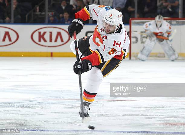 Mark Giordano of the Calgary Flames shoots the puck against the New York Rangers at Madison Square Garden on February 24 2015 in New York City The...