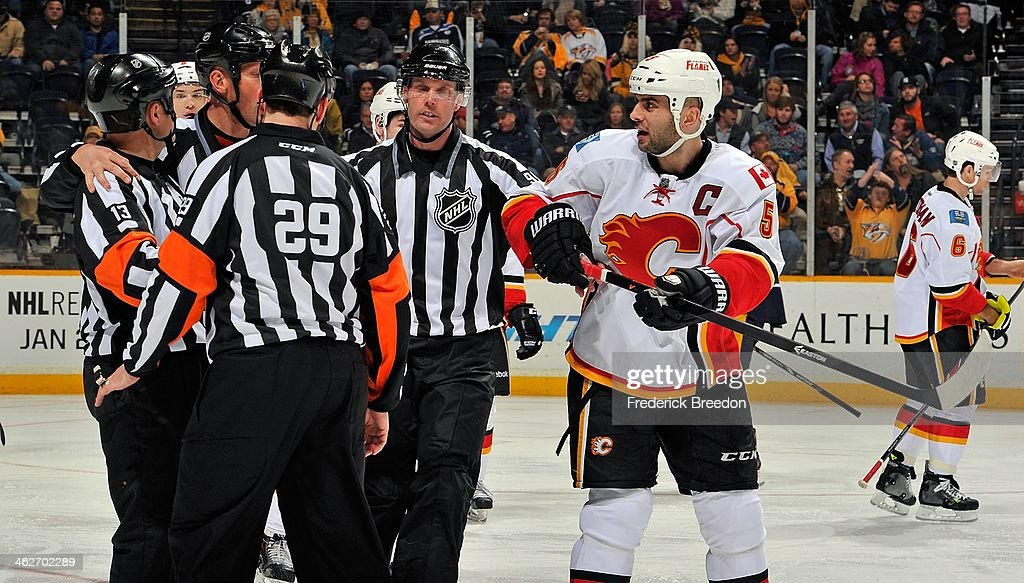 <a gi-track='captionPersonalityLinkClicked' href=/galleries/search?phrase=Mark+Giordano&family=editorial&specificpeople=696867 ng-click='$event.stopPropagation()'>Mark Giordano</a> #5 of the Calgary Flames shows referees Ian Walsh #29 and <a gi-track='captionPersonalityLinkClicked' href=/galleries/search?phrase=Dan+O%27Halloran&family=editorial&specificpeople=622039 ng-click='$event.stopPropagation()'>Dan O'Halloran</a> #13 how he was holding his stick after a goal was waived off against the Nashville Predators at Bridgestone Arena on January 14, 2014 in Nashville, Tennessee.