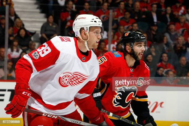Mark Giordano of the Calgary Flames skates against Anthony Mantha of the Detroit Red Wings during an NHL game on November 9 2017 at the Scotiabank...
