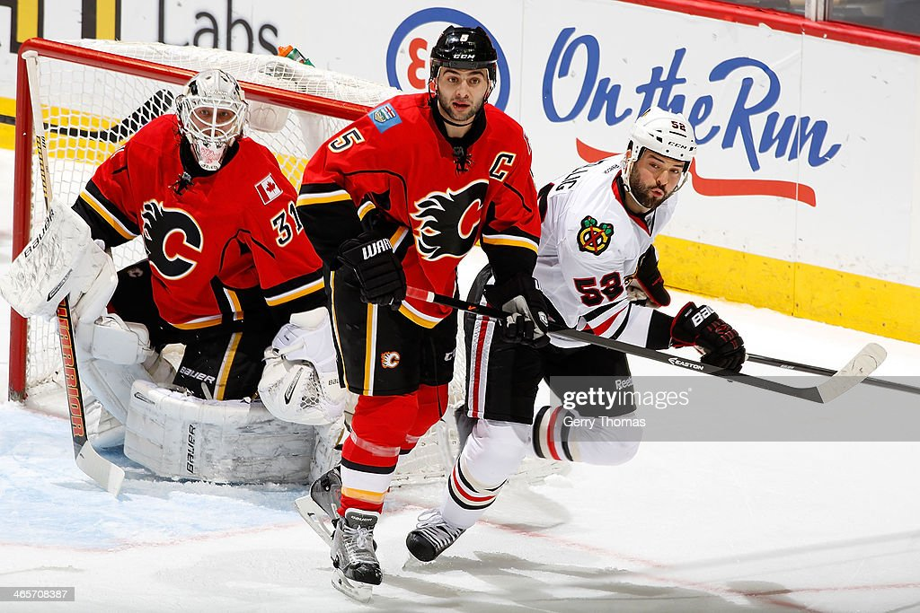 <a gi-track='captionPersonalityLinkClicked' href=/galleries/search?phrase=Mark+Giordano&family=editorial&specificpeople=696867 ng-click='$event.stopPropagation()'>Mark Giordano</a> #5 of the Calgary Flames skates against <a gi-track='captionPersonalityLinkClicked' href=/galleries/search?phrase=Brandon+Bollig&family=editorial&specificpeople=7186858 ng-click='$event.stopPropagation()'>Brandon Bollig</a> #52 of the Chicago Blackhawks at Saddledome on January 28, 2014 in Calgary, Alberta, Canada.