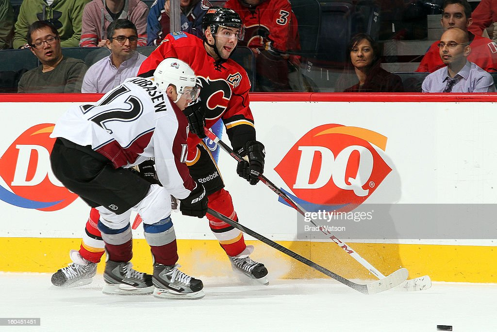 <a gi-track='captionPersonalityLinkClicked' href=/galleries/search?phrase=Mark+Giordano&family=editorial&specificpeople=696867 ng-click='$event.stopPropagation()'>Mark Giordano</a> #5 of the Calgary Flames skates against <a gi-track='captionPersonalityLinkClicked' href=/galleries/search?phrase=Chuck+Kobasew&family=editorial&specificpeople=208995 ng-click='$event.stopPropagation()'>Chuck Kobasew</a> #12 of the Colorado Avalanche on January 31, 2013 at the Scotiabank Saddledome in Calgary, Alberta, Canada.