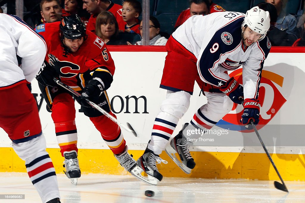 Mark Giordano #5 of the Calgary Flames skates against <a gi-track='captionPersonalityLinkClicked' href=/galleries/search?phrase=Colton+Gillies&family=editorial&specificpeople=4111551 ng-click='$event.stopPropagation()'>Colton Gillies</a> #9 of the Columbus Blue Jackets on March 29, 2013 at the Scotiabank Saddledome in Calgary, Alberta, Canada.