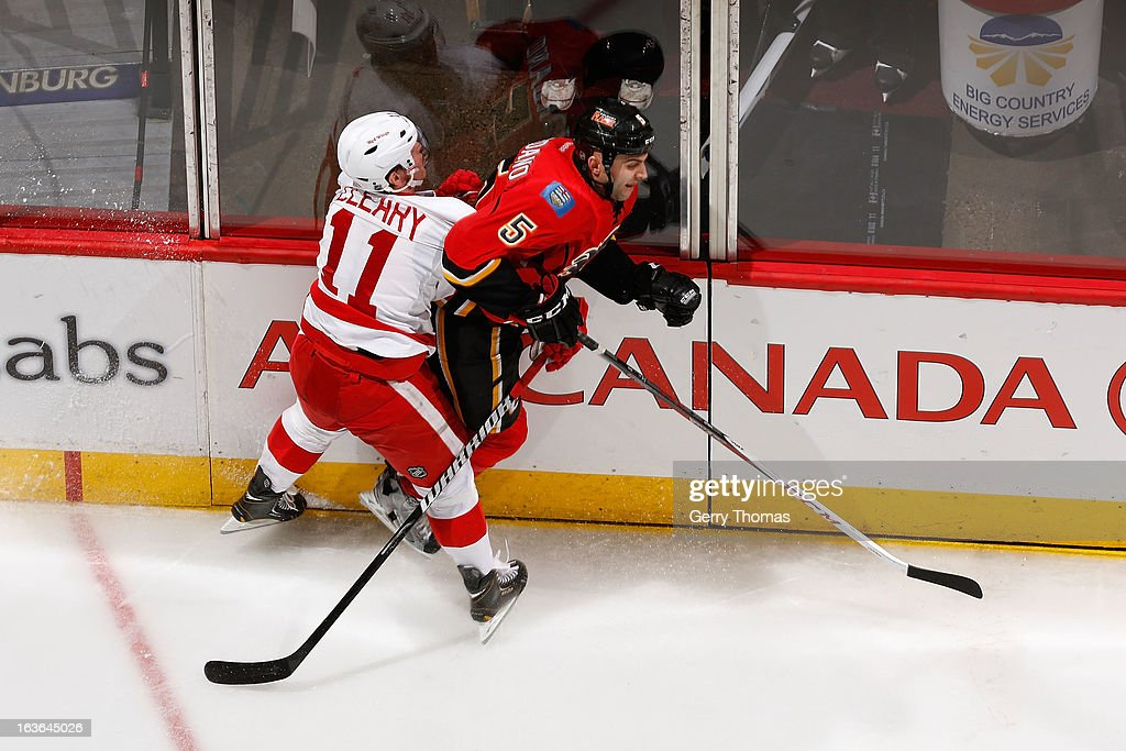 <a gi-track='captionPersonalityLinkClicked' href=/galleries/search?phrase=Mark+Giordano&family=editorial&specificpeople=696867 ng-click='$event.stopPropagation()'>Mark Giordano</a> #5 of the Calgary Flames skates against <a gi-track='captionPersonalityLinkClicked' href=/galleries/search?phrase=Daniel+Cleary&family=editorial&specificpeople=220490 ng-click='$event.stopPropagation()'>Daniel Cleary</a> #11 of the Detroit Red Wings on March 13, 2013 at the Scotiabank Saddledome in Calgary, Alberta, Canada.
