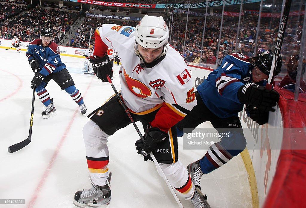 <a gi-track='captionPersonalityLinkClicked' href=/galleries/search?phrase=Mark+Giordano&family=editorial&specificpeople=696867 ng-click='$event.stopPropagation()'>Mark Giordano</a> #5 of the Calgary Flames skates against <a gi-track='captionPersonalityLinkClicked' href=/galleries/search?phrase=Jamie+McGinn&family=editorial&specificpeople=537964 ng-click='$event.stopPropagation()'>Jamie McGinn</a> #11 of the Colorado Avalanche at the Pepsi Center on April 8, 2013 in Denver, Colorado. Calgary beat Colorado 3-1.