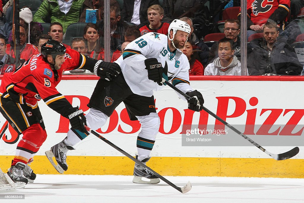 <a gi-track='captionPersonalityLinkClicked' href=/galleries/search?phrase=Mark+Giordano&family=editorial&specificpeople=696867 ng-click='$event.stopPropagation()'>Mark Giordano</a> #5 of the Calgary Flames skates against <a gi-track='captionPersonalityLinkClicked' href=/galleries/search?phrase=Joe+Thornton&family=editorial&specificpeople=201829 ng-click='$event.stopPropagation()'>Joe Thornton</a> #19 of the San Jose Sharks at Scotiabank Saddledome on March 24, 2014 in Calgary, Alberta, Canada.