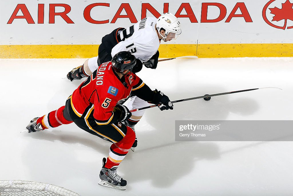 <a gi-track='captionPersonalityLinkClicked' href=/galleries/search?phrase=Mark+Giordano&family=editorial&specificpeople=696867 ng-click='$event.stopPropagation()'>Mark Giordano</a> #5 of the Calgary Flames skates against <a gi-track='captionPersonalityLinkClicked' href=/galleries/search?phrase=Nick+Bonino&family=editorial&specificpeople=5805660 ng-click='$event.stopPropagation()'>Nick Bonino</a> #13 of the Anaheim Ducks at Scotiabank Saddledome on March 26, 2014 in Calgary, Alberta, Canada.