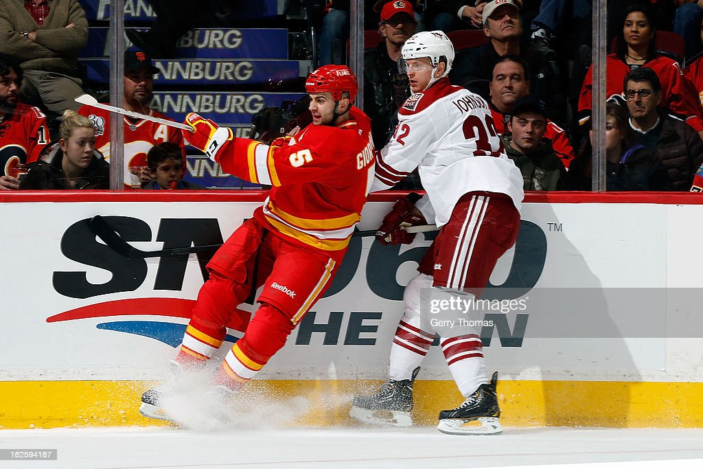 <a gi-track='captionPersonalityLinkClicked' href=/galleries/search?phrase=Mark+Giordano&family=editorial&specificpeople=696867 ng-click='$event.stopPropagation()'>Mark Giordano</a> #5 of the Calgary Flames skates against Nick Johnson #32 of the Phoenix Coyotes on February 24, 2013 at the Scotiabank Saddledome in Calgary, Alberta, Canada.