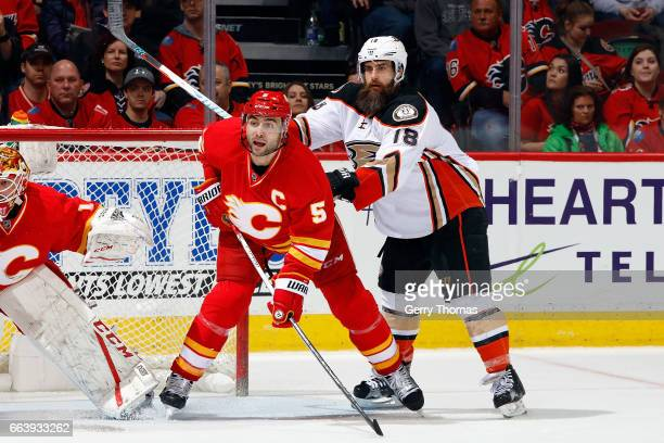 Mark Giordano of the Calgary Flames skates against Patrick Eaves of the Anaheim Ducks during an NHL game on April 2 2017 at the Scotiabank Saddledome...