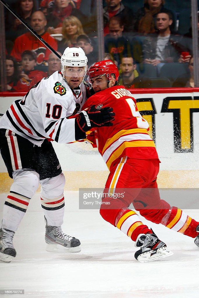 Mark Giordano #5 of the Calgary Flames skates against Patrick Sharp #10 of the Chicago Blackhawks on February 2, 2013 at the Scotiabank Saddledome in Calgary, Alberta, Canada.