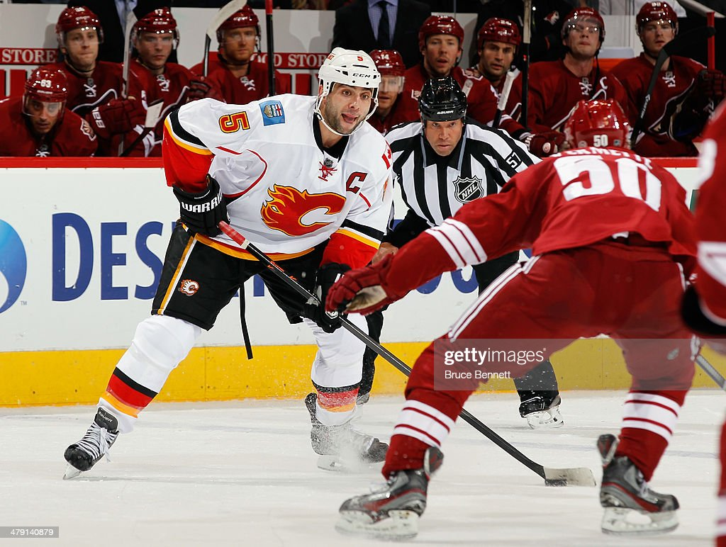 <a gi-track='captionPersonalityLinkClicked' href=/galleries/search?phrase=Mark+Giordano&family=editorial&specificpeople=696867 ng-click='$event.stopPropagation()'>Mark Giordano</a> #5 of the Calgary Flames skates against the Phoenix Coyotes at the Jobing.com Arena on March 15, 2014 in Glendale, Arizona. The Coyotes defeated the Flames 3-2.