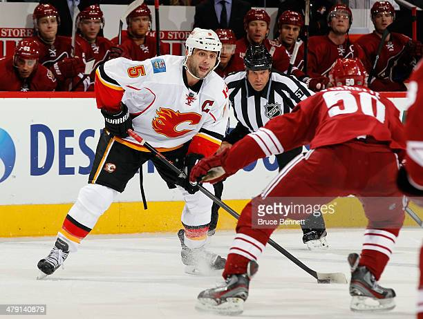 Mark Giordano of the Calgary Flames skates against the Phoenix Coyotes at the Jobingcom Arena on March 15 2014 in Glendale Arizona The Coyotes...