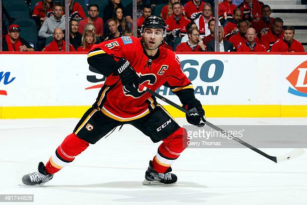 Mark Giordano of the Calgary Flames skates against the Vancouver Canucks at Scotiabank Saddledome during the NHL season opener on October 7 2015 in...