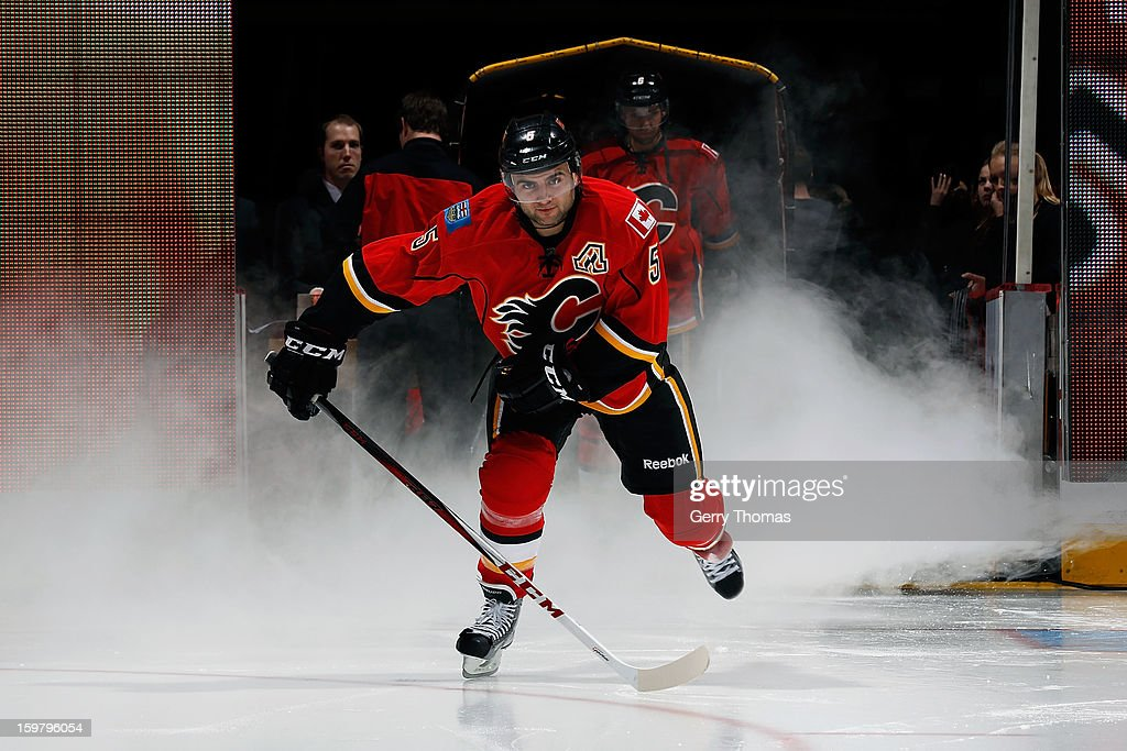 <a gi-track='captionPersonalityLinkClicked' href=/galleries/search?phrase=Mark+Giordano&family=editorial&specificpeople=696867 ng-click='$event.stopPropagation()'>Mark Giordano</a> #5 of the Calgary Flames skates onto the ice during player introductions before the game against the San Jose Sharks on January 20, 2013 at the Scotiabank Saddledome in Calgary, Alberta, Canada.