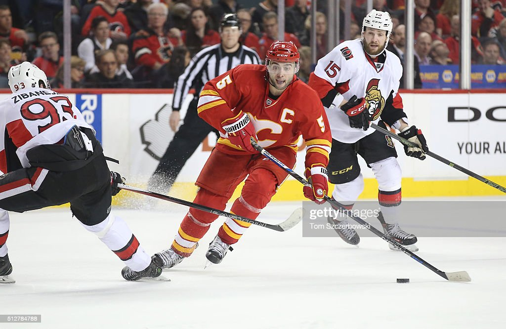 Mark Giordano #5 of the Calgary Flames skates with the puck during their NHL game against the Ottawa Senators at the Scotiabank Saddledome on February 27, 2016 in Calgary, Alberta, Canada.