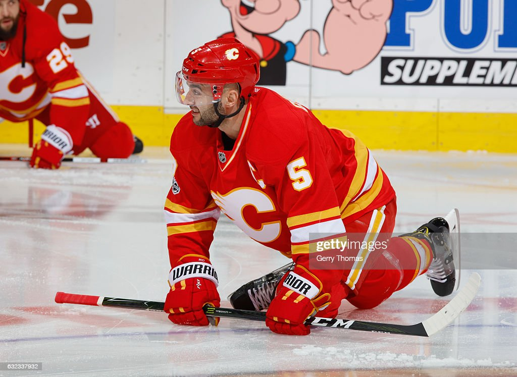 Mark Giordano #5 of the Calgary Flames stretches in warm up prior to the game against the Edmonton Oilers at Scotiabank Saddledome on January 21, 2017 in Calgary, Alberta, Canada.