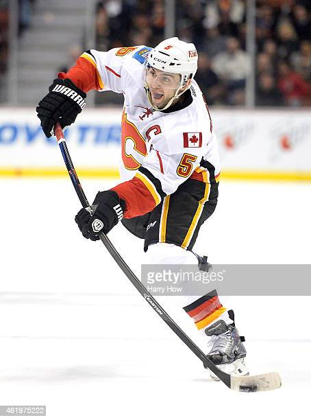Mark Giordano of the Calgary Flames takes a shot durig the game against the Anaheim Ducks at Honda Center on January 21 2015 in Anaheim California