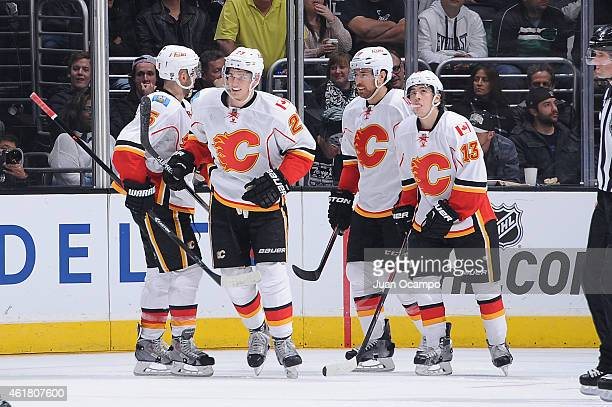 Mark Giordano Sean Monahan Matt Stajan and Johnny Gaudreau of the Calgary Flames celebrate during a game against the Los Angeles Kings at STAPLES...