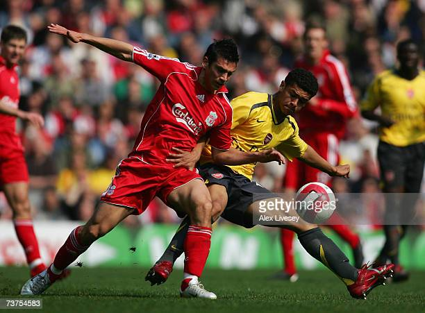 Mark Gonzalez of Liverpool fights for the ball with Denilson of Arsenal during the Barclays Premiership match between Liverpool and Arsenal at...