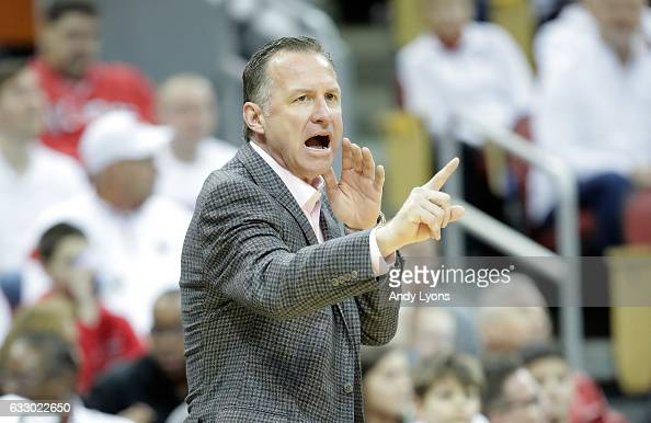 Mark Gottfried the head coach of the North Carolina State Wolfpack gives instructions to his team during the game against the Louisville Cardinals at...
