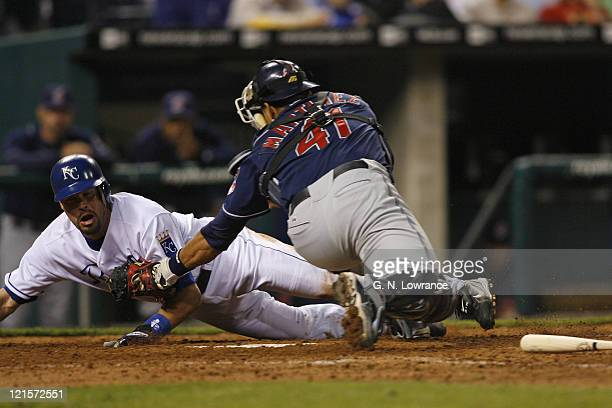 Mark Grudzielanek of the Royals is tagged out by catcher Victor Martinez during action between the Cleveland Indians and Kansas City Royals at...