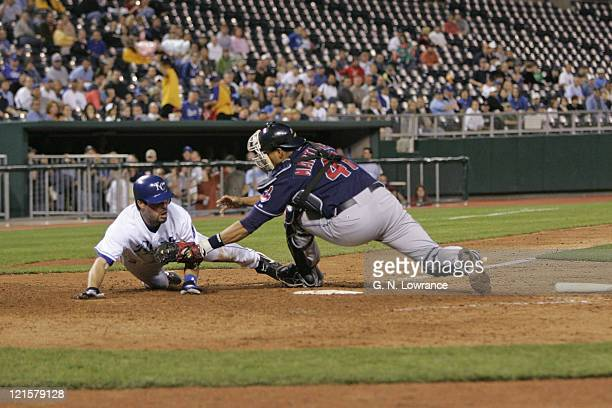 Mark Grudzielanek of the Royals is tagged out by Victor Martinez during action between the Cleveland Indians and Kansas City Royals at Kauffman...