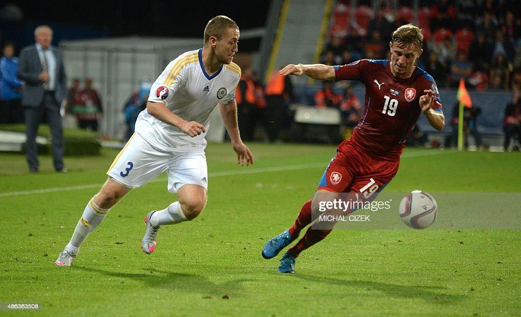 Mark Gurman of Kazakhstan vies for a ball with Ladislav Krejci of Czech Republic during their UEFA Euro 2016 qualifying round football match against...