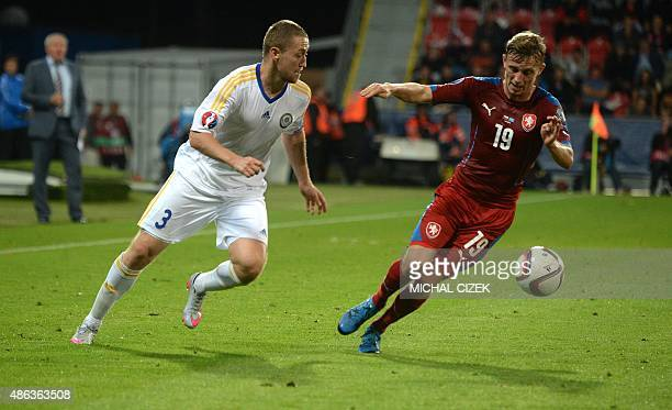 Mark Gurman of Kazakhstan vies for a ball with Ladislav Krejci of Czech Republic during their UEFA Euro 2016 qualifying round football match against...