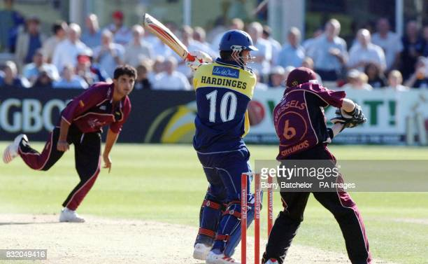 Mark Hardinges of Gloucestershire Gladiators hits a shot past Northamptonshire Steelbacks wicket keeper Riki Wessels off the bowling of Sourav...