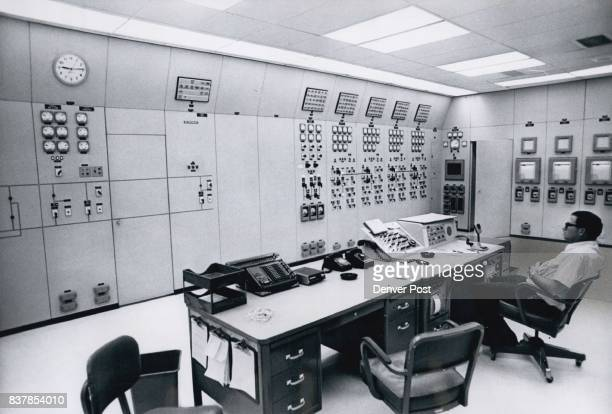 Mark Harper of Fort Smith Mont sits at control desk in control room inside Yellowtail Dam and power plant This room links the 250000kilowatt...