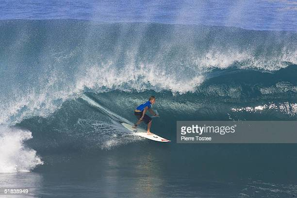 Mark Healey of Hawaii competes in the Rip Curl Pipe Masters on December 8 2004 at Pipeline of the North Shore of Oahu Hawaii