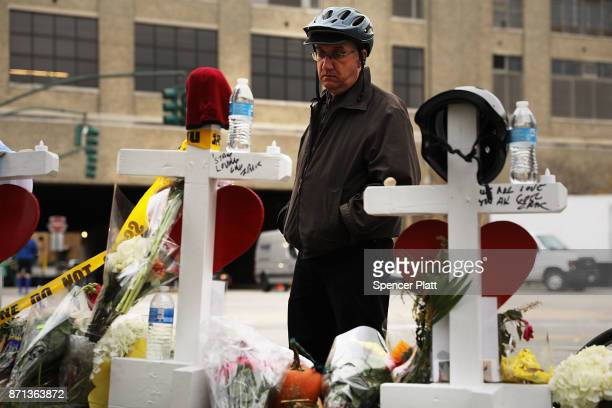 Mark Hennen looks at the eight crosses marking the location where terrorist Sayfullo Saipov entered a Manhattan bike path and went on a rampage with...