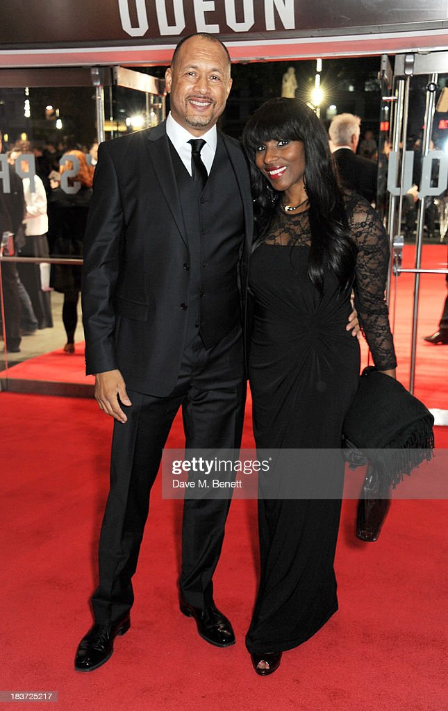 Mark Holden (L) and wife Patty attend the European Premiere of 'Captain Phillips' on the opening night of the 57th BFI London Film Festival at Odeon Leicester Square on October 9, 2013 in London, England.